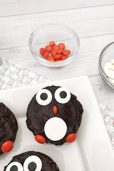 Christmas penguin brownies are such an adorable and delicious dessert to serve up to your family and friends. You have a fudgy homemade brownie that is decorated with candies to resemble a penguin.