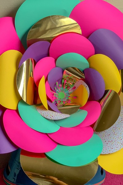 colorful giant paper flower sitting up