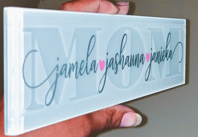 etched white glass tile with silver and pink accents