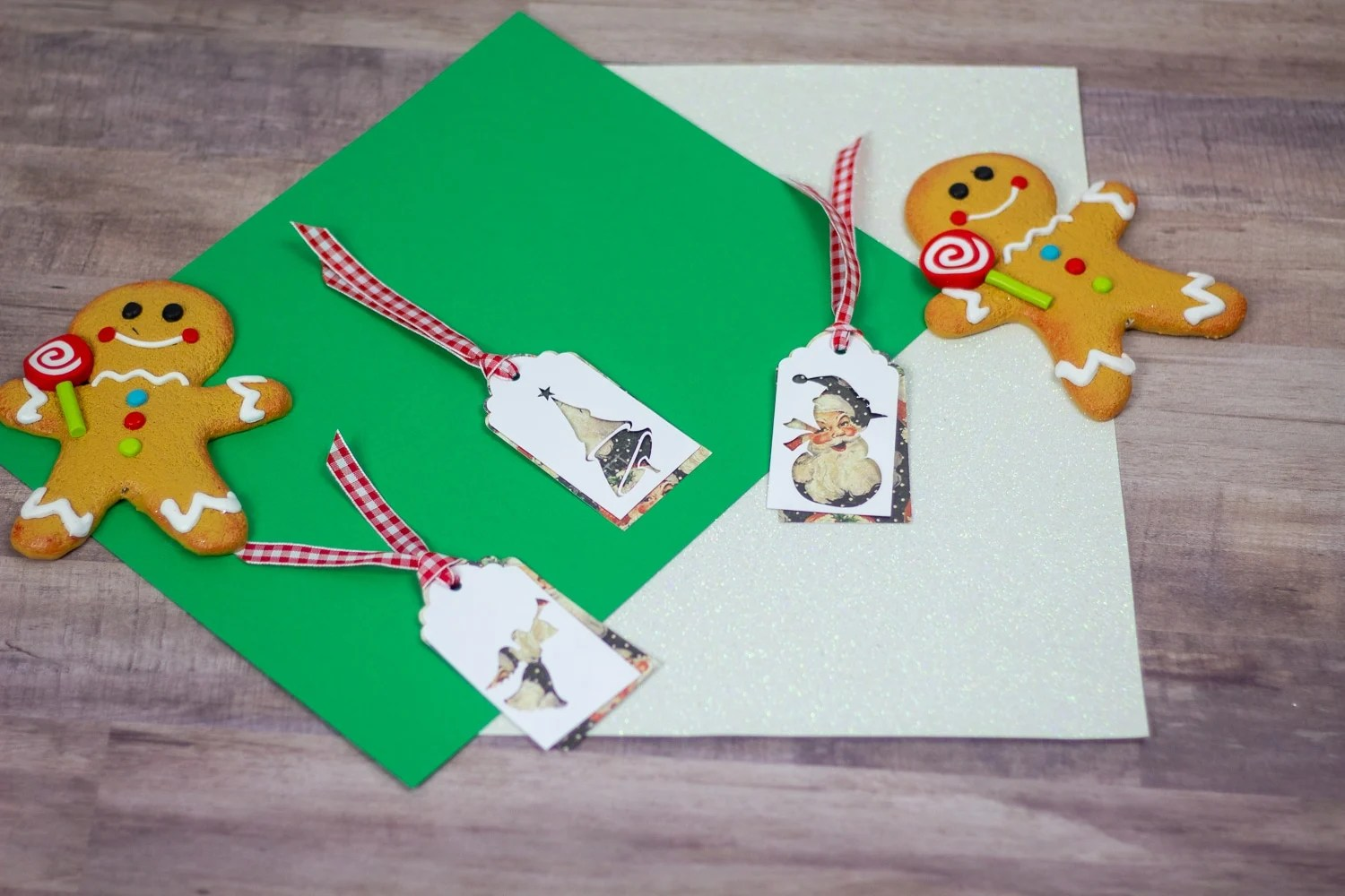 Image of gingerbread men with Christmas Gift Tags that have Christmas graphics on them.