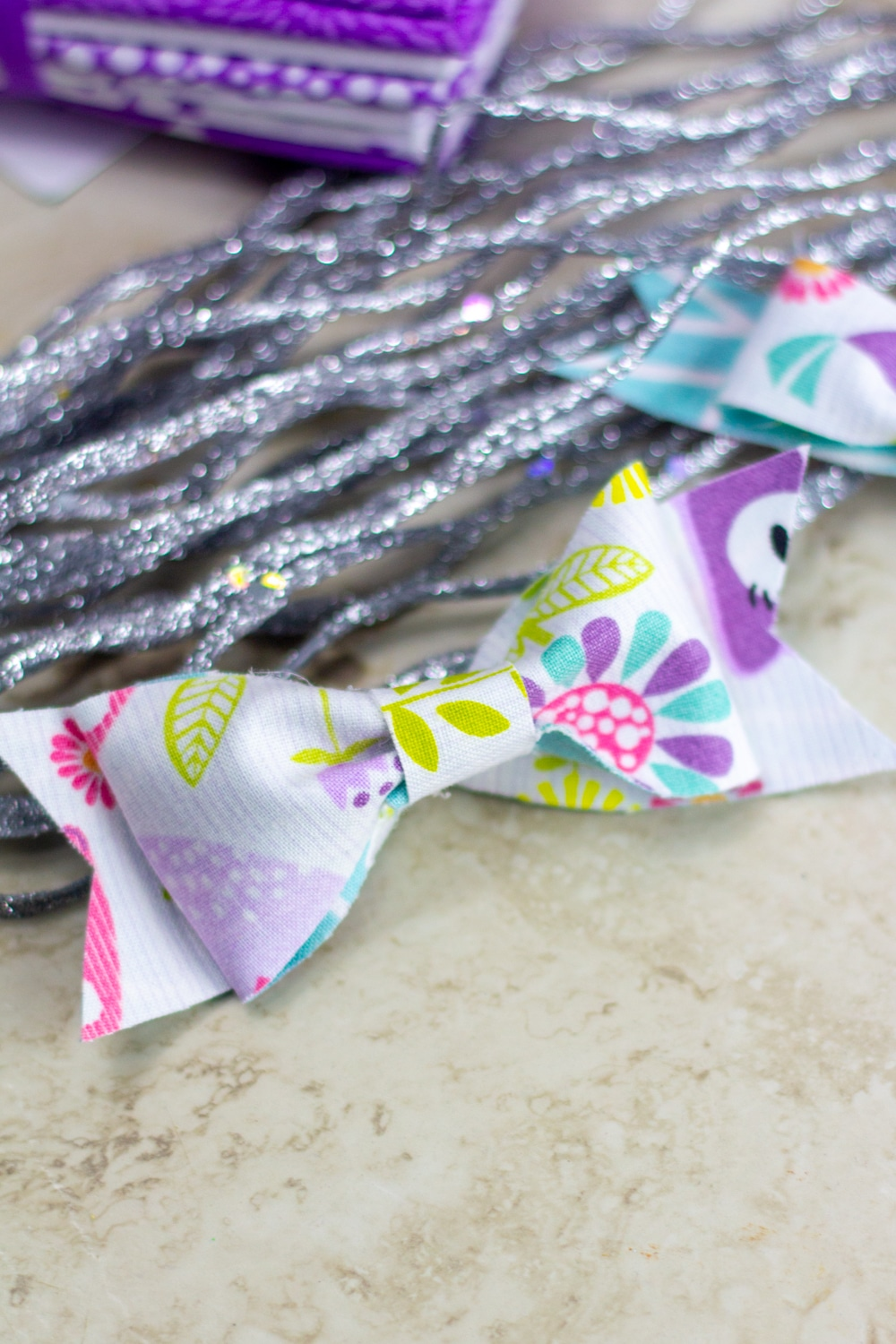 no sew bow made with the cricut maker and colorful fat quarters