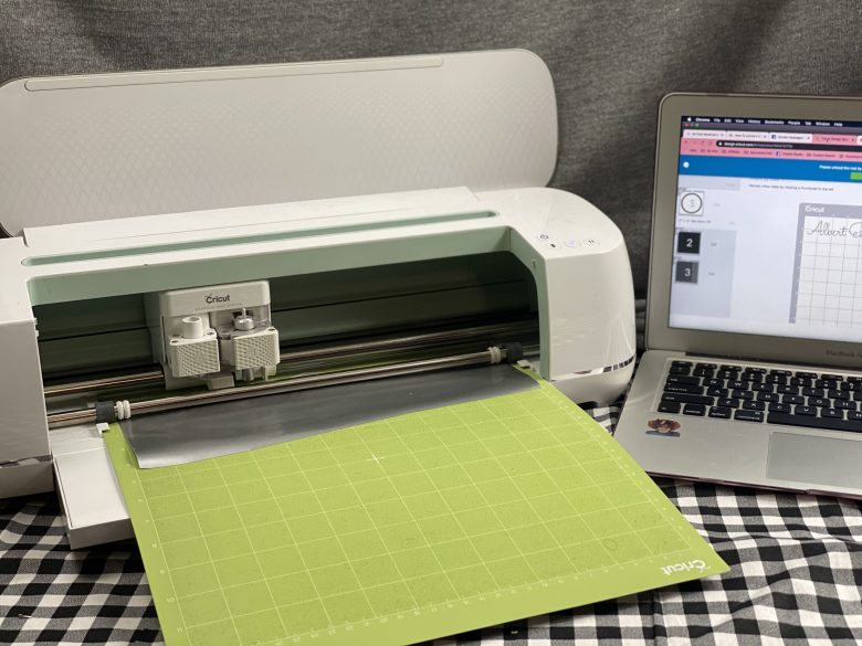 cricut maker with imac, green mat and tools
