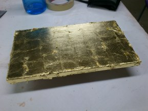 Panel covered in gold leaf