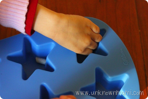 Filling silicone mold with crayons