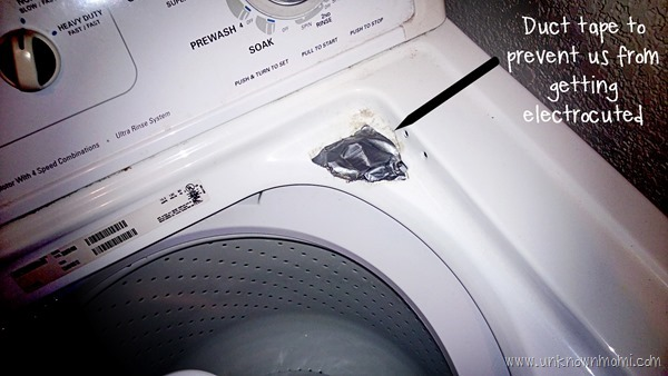 Broken washing machine with duct tape