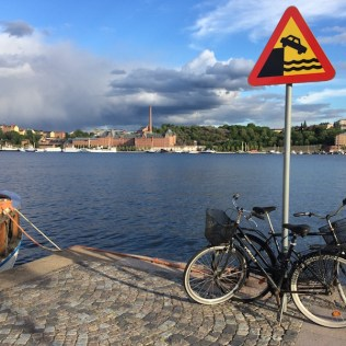 A summer evening view of Sodermalm from the walking path, Monteliusvägen, in Kungsholmen, Stockholm, overlooking the Riddarfjarden bay. By C.S. White