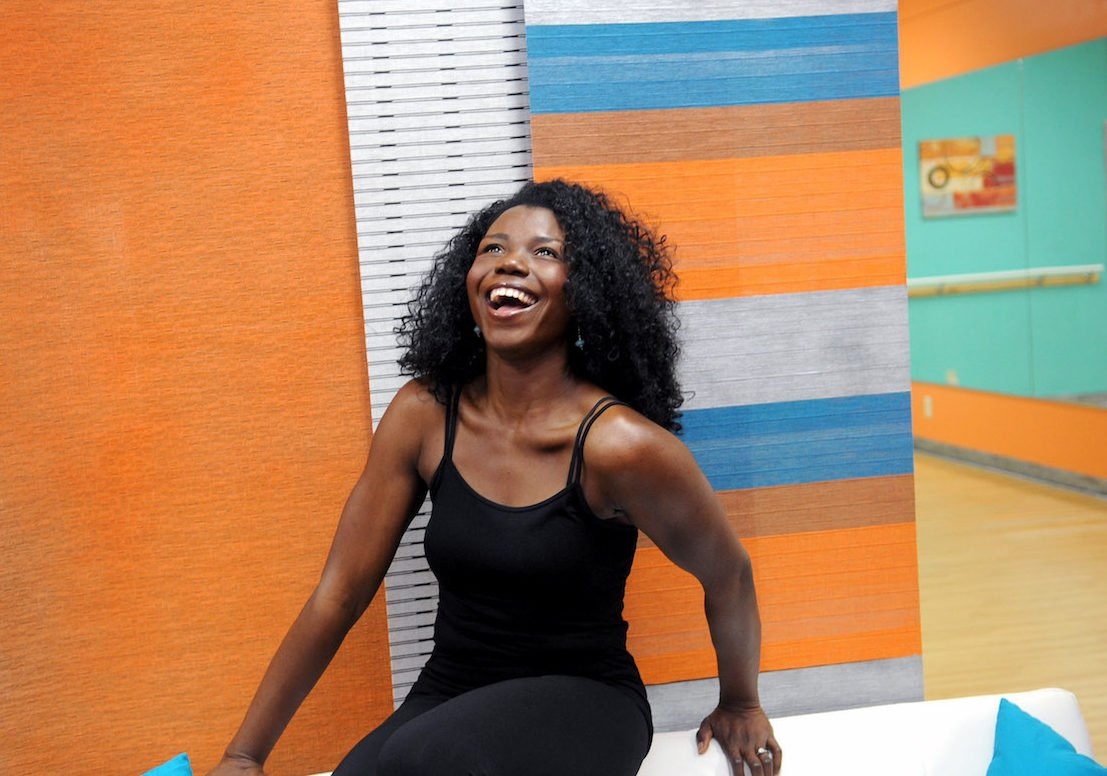 Image of 'Dami smiling at Passion Barre Studio