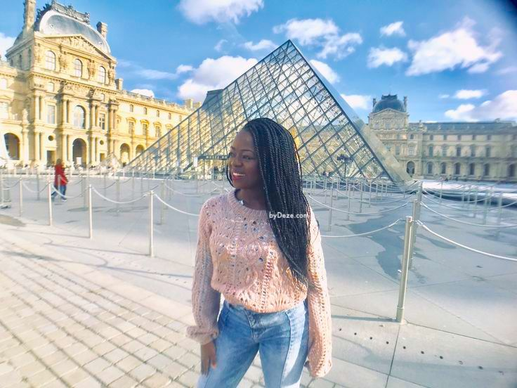 a picture in front of the Louvre pyramid in Paris