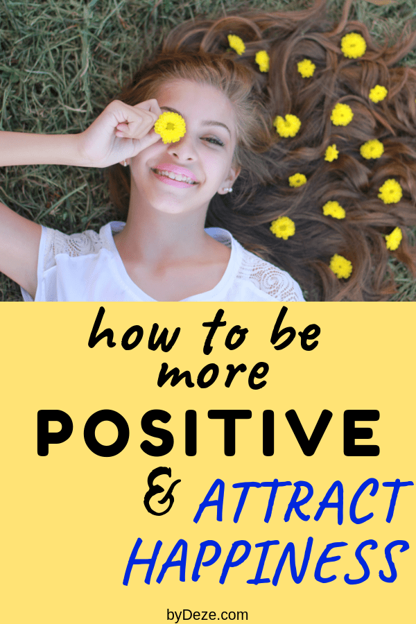 a girl with yellow flowers saying how to be more positive and attract happiness