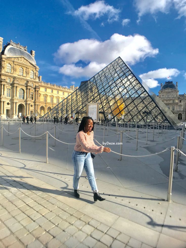 walking in front of the Louvre when you travel to Paris