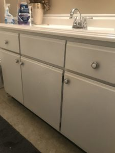 a picture of the vanity before the bathroom makeover