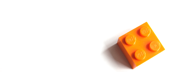 An orange lego. Here are home management tips on toy organization.