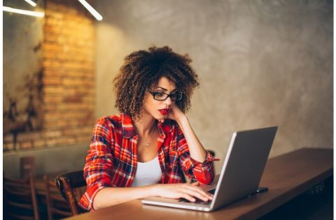 woman on laptop reading about emotional breakthrough