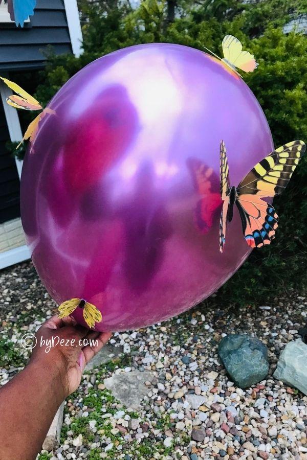 close up diy balloon craft with butterflies