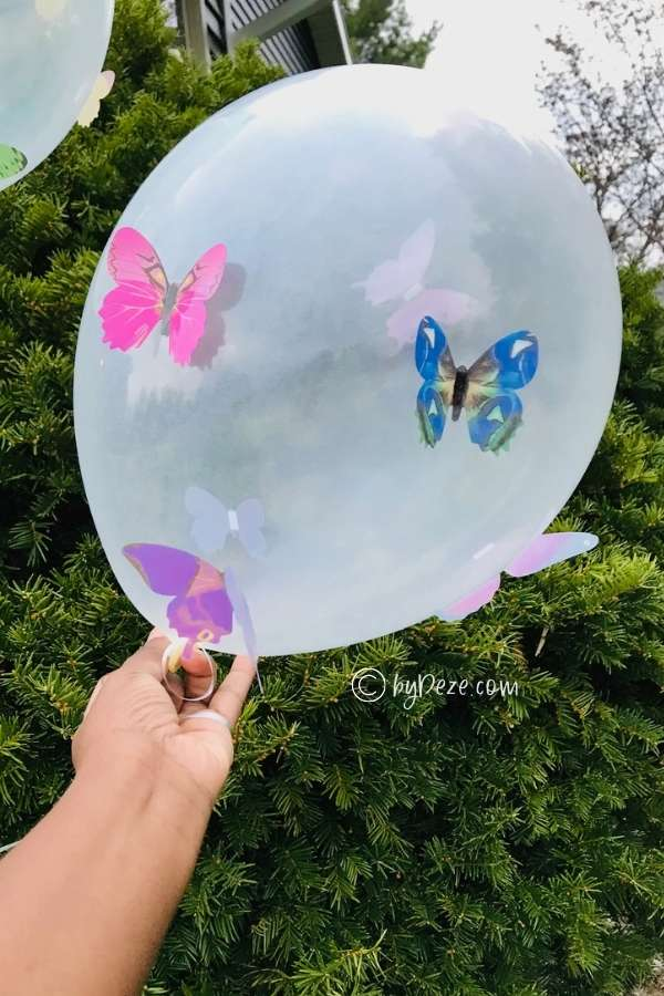 close up of clear balloon with butterflies