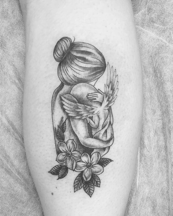 mommy hugging angel baby memorial tattoo with flowers