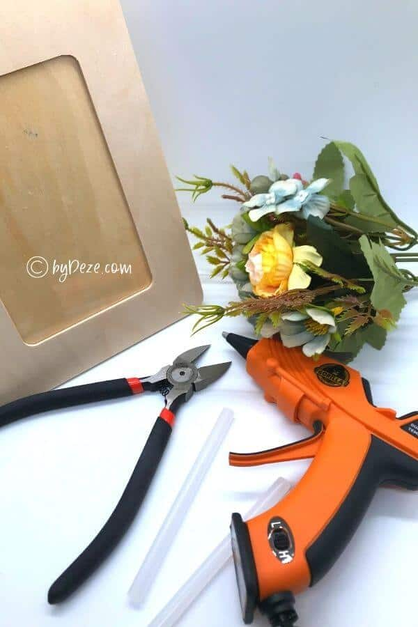 floral photo frame project flat lay