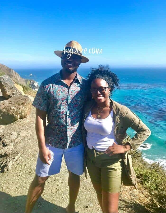 a couple posed on the big sur coastline during road trip