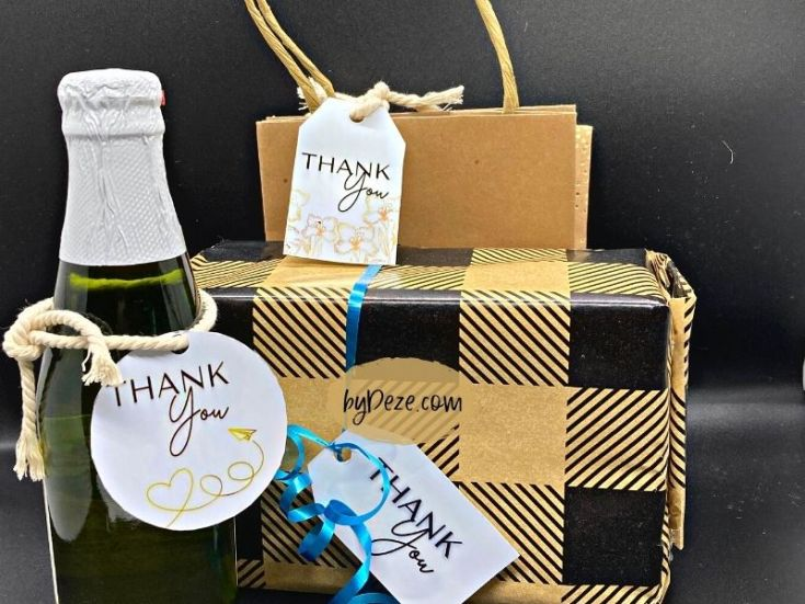 printed thank you gift tags displayed on bags and wine