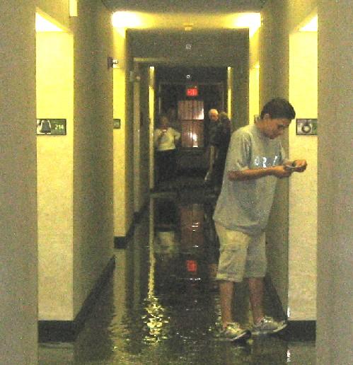 Man balances on his heels wading through the water