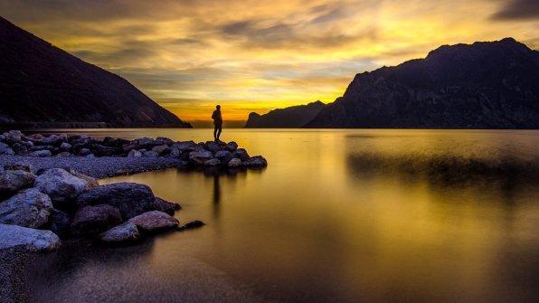 Man Standing on a Lake