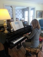 Mom practicing piano at my Uncle's house