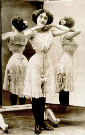 Circa 1900 - a woman in drawers, chemise and corset