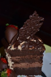 Flourless chocolate cake filled with whipped chocolate mousse, covered in peanut butter butter cream and drizzled with chocolate ganache. Don't forget about the chocolate covered strawberries!! Order now at By Grace Cakes!