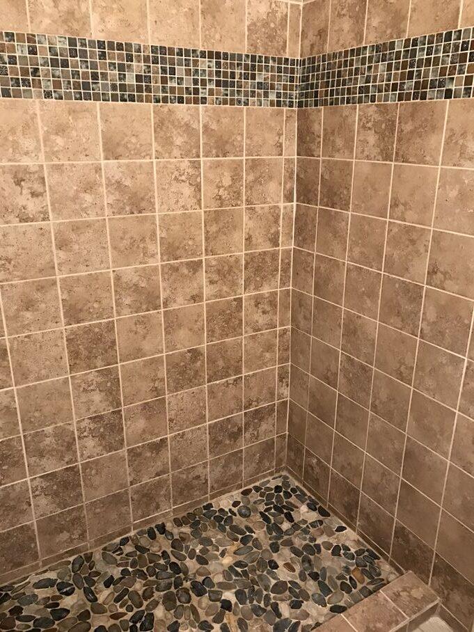 pebble tile shower floor bathtoom