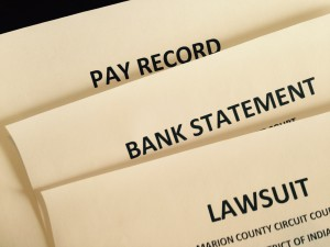 Photo of pay record, bank statements, and lawsuits