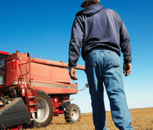 Image illustrating Indiana Farmer filing Chapter 12 bankruptcy to save family farm.