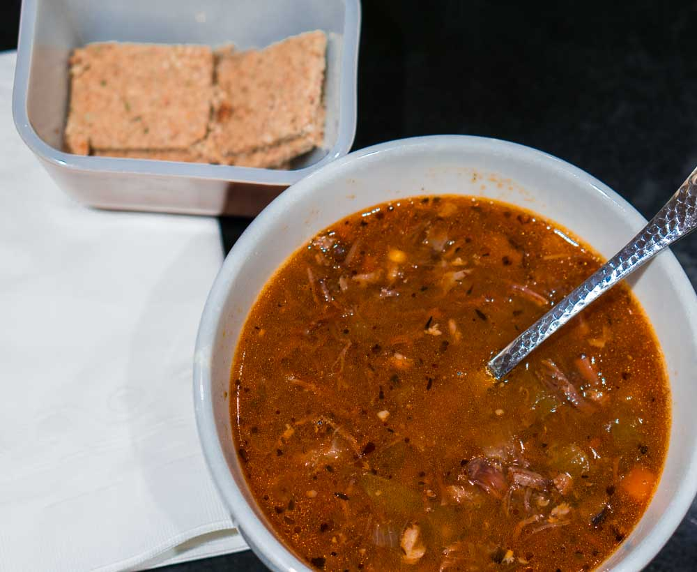 Bowl of Beef Soup and Crackers