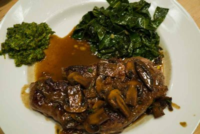 steak served with collard greens