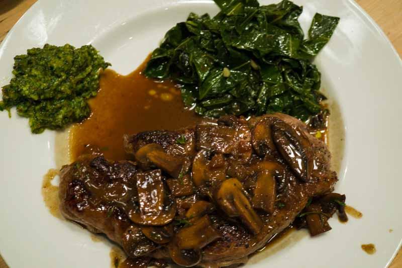 Steak with collard greens