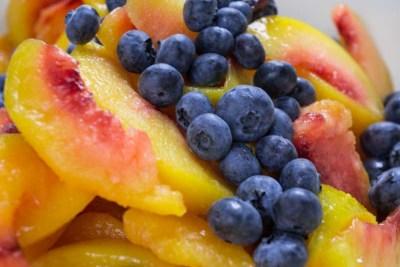 peaches blueberries macro shot