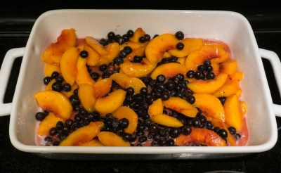 peaches and blueberries in baking dish