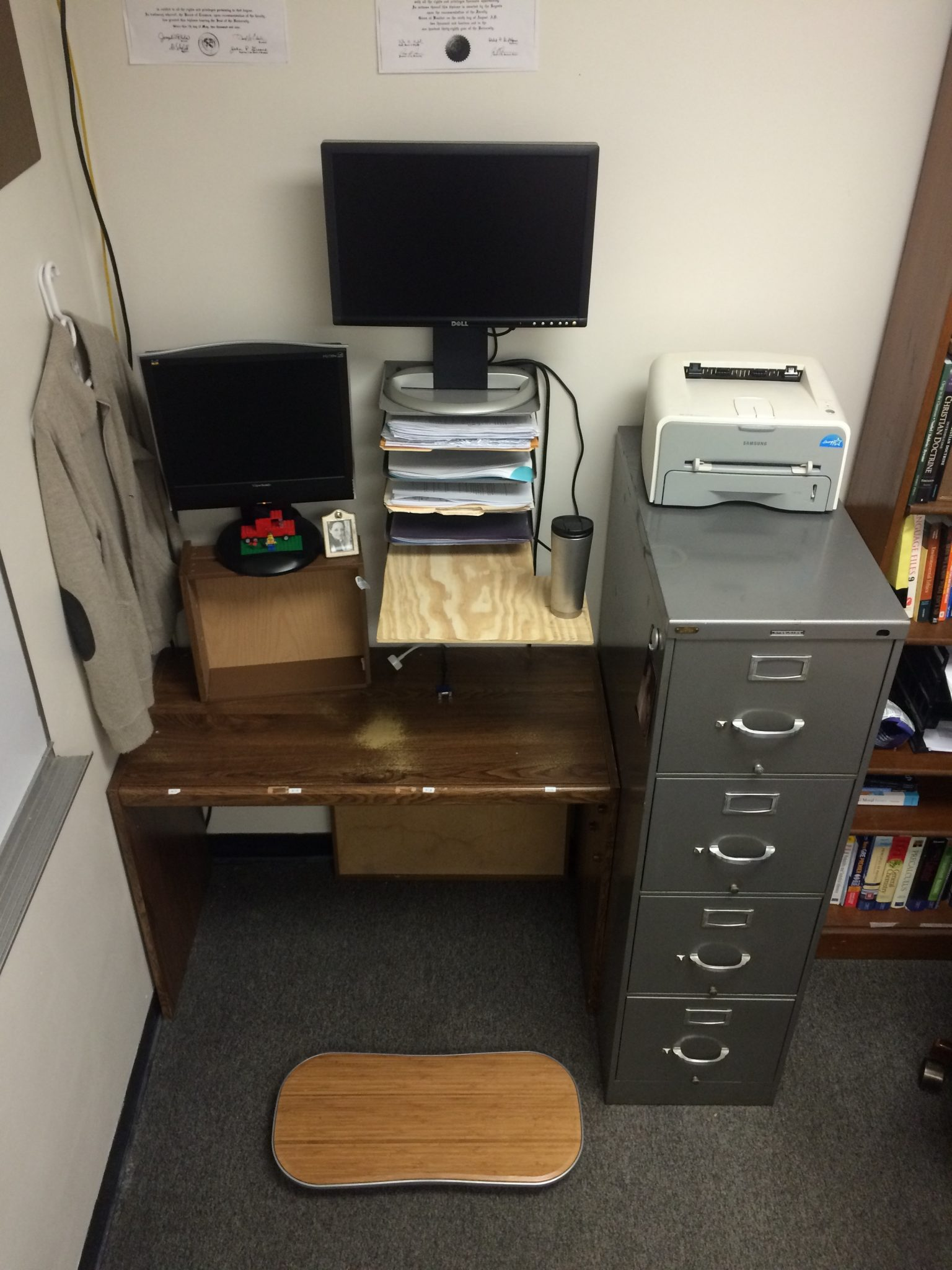 The recycled-drawer-slash-organizer-slash-plywood sit-stand desk.