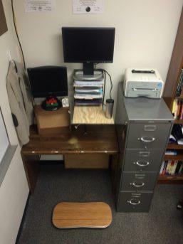 The recycled-drawer-slash-organizer-slash-plywood sit-stand desk.