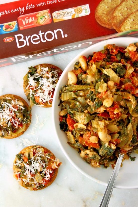 Italian Greens & Beans Bruschetta is everything you love about Greens & Beans.. served on a tender, flaky cracker. Serve warm or cold at your next gathering for a simple hors d'oeuvre that is sure to impress! | www.bytesizednutrition.com