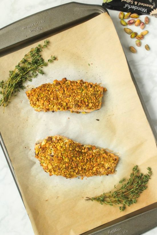 This Herbed Goat Cheese and Pistachio Crusted Salmon is as easy as it is delicious! A 15-minute heart healthy dinner that's fancy enough for date night, yet easy enough for a hectic weeknight! | www.bytesizednutrition.com