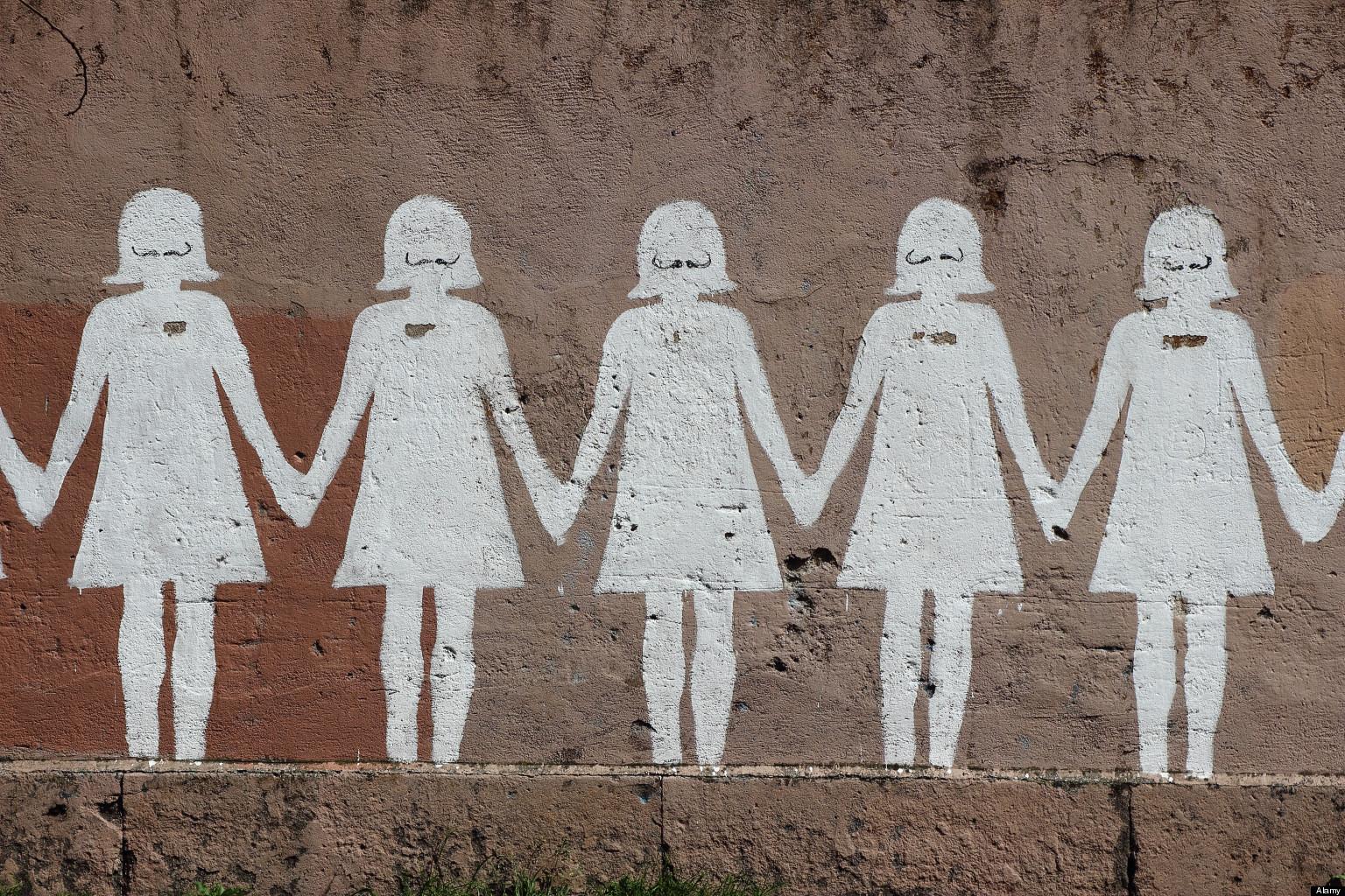 D56H22 Paper doll graffiti in a public street - Rome