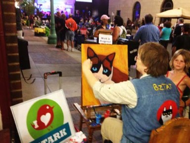 Artist BZTAT painting at Outdoor Concert