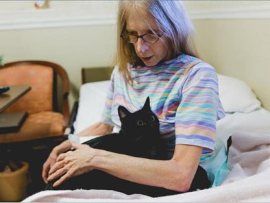 Isis and Joan, Black Cat with woman in Hospice care