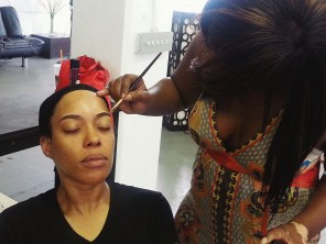 Storm's Makeup getting done by Safary Marion