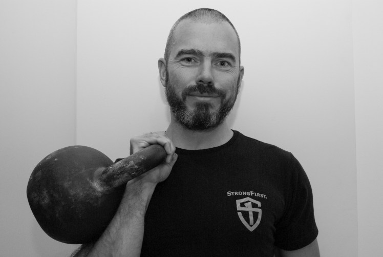 One handed Rack Carry - Loaded Carry - Continuous  Improvement Fitness