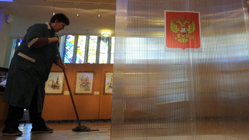 File pic of a cleaner in a Moscow polling station