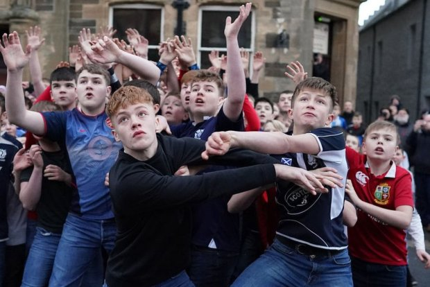 Orkadian youths take part in the Boys New Year's Ba' Game played with a hand crafted leather ball on 1 January 2020 in Kirkwall Scotland.