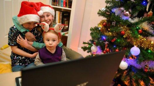 Children next to Christmas tree
