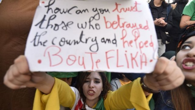 An Algerian protester holds up a placard during an anti-government demonstration in the capital Algiers on 11 December 2019, ahead of the presidential vote.