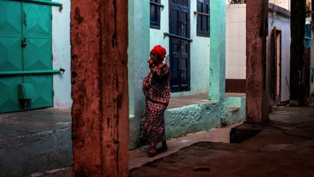 A woman is pictures in the medina of Mutsamudu, the capital of Anjouan Island, Comoros, March 2019